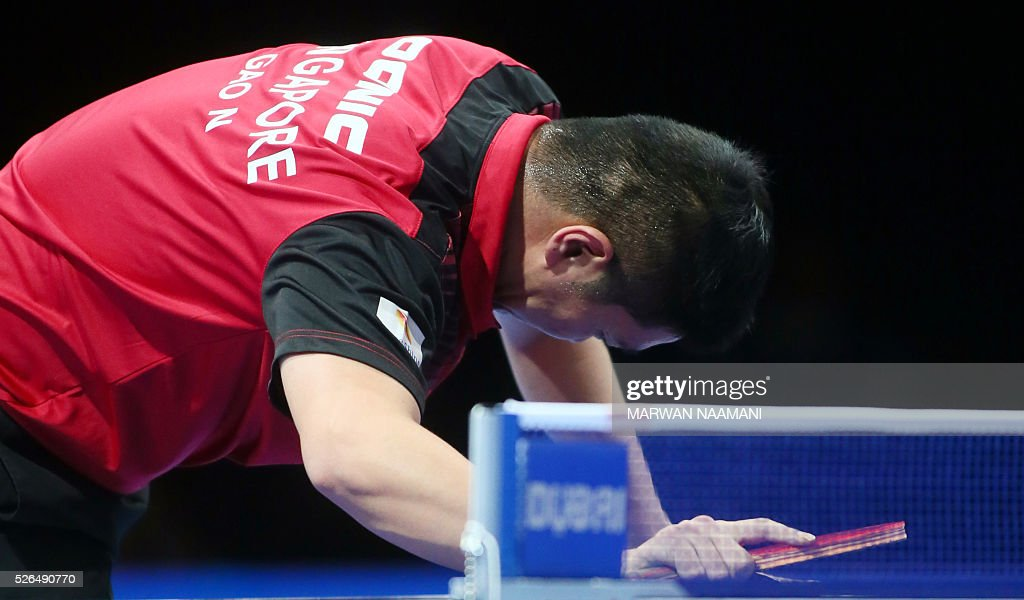 Gao Ning of Singapore reacts after losing a point against Wong Chun Ting of Hong Kong during their men's singles third and fourth place table tennis match in the ITTF Nakheel Table Tennis Asian Cup, on April 30, 2016 in Dubai. / AFP / MARWAN