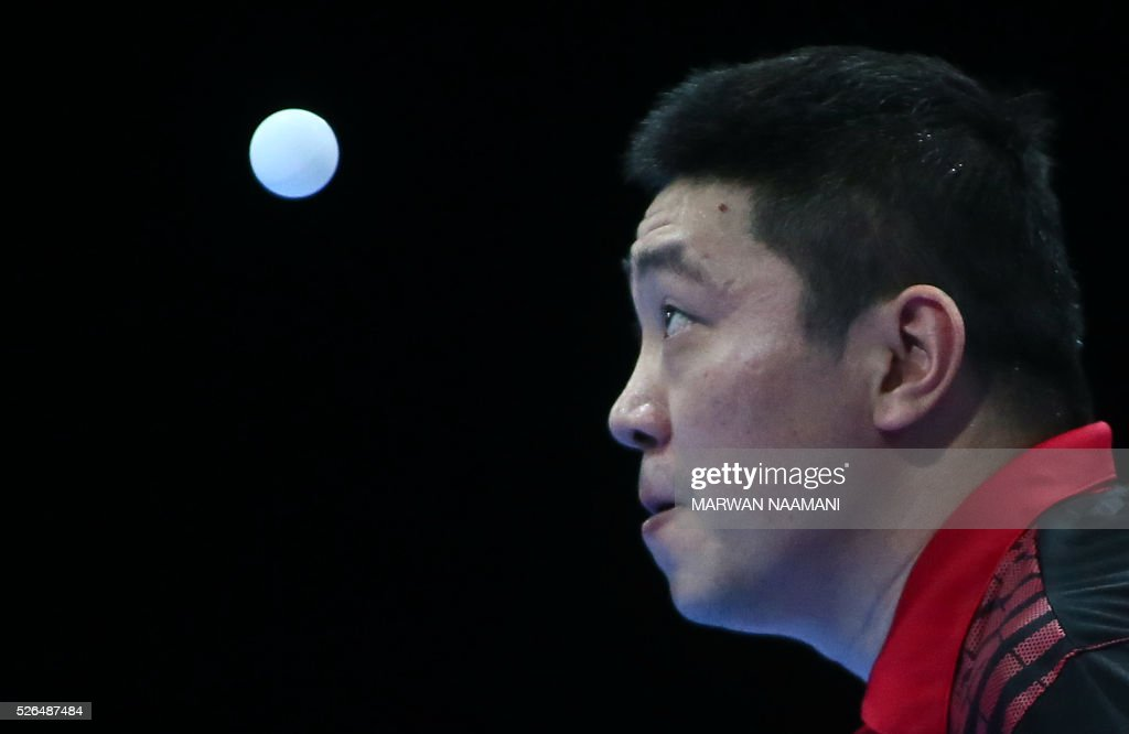 Gao Ning of Singapore returns the ball to Wong Chun Ting of Hong Kong during their men's singles third and fourth place table tennis match in the ITTF Nakheel Table Tennis Asian Cup, on April 30, 2016 in Dubai. / AFP / MARWAN
