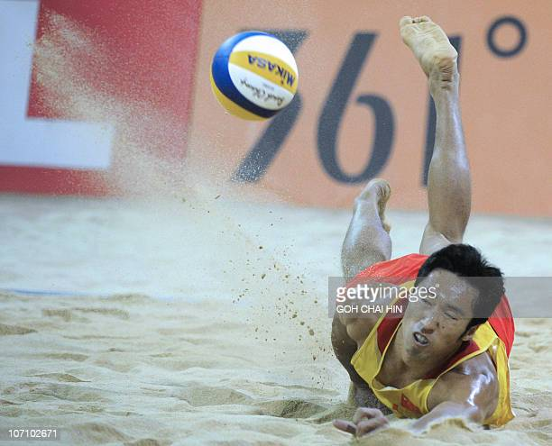 Gao Peng of China tries to retrieve a shot during the beach volleyball men's final match at the 16th Asian Games in Guangzhou on November 24 2010 Xu...