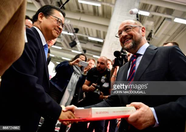 Gao Xuanmin secretary general of the Organization Department of the Central Committee of the Communist Party of China shakes hands with the leader of...