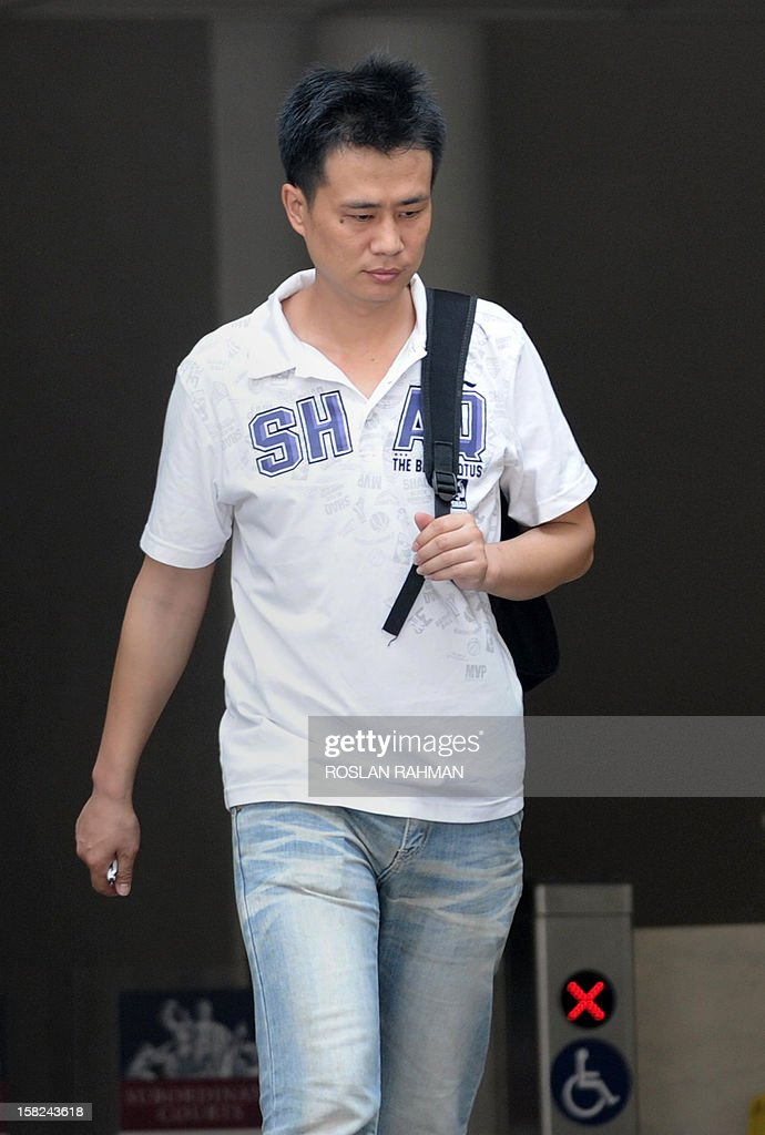 Gao Yue Qiang, 32, one of four Chinese bus drivers facing possible jail for instigating Singapore's first industrial strike in 26 years, leaves the subordinate courts in Singapore on December 12, 2012. Four Chinese bus drivers facing possible jail were given more time on December 12 to explore their legal options and were told to report again on December 19 for a new pre-trial conference. AFP PHOTO / ROSLAN RAHMAN