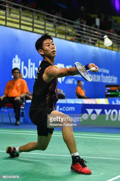Gao Zhengze of China competes against Uriel Francisco Canjura Artiga of El Salvador during Men Single qualification round of the BWF World Junior...