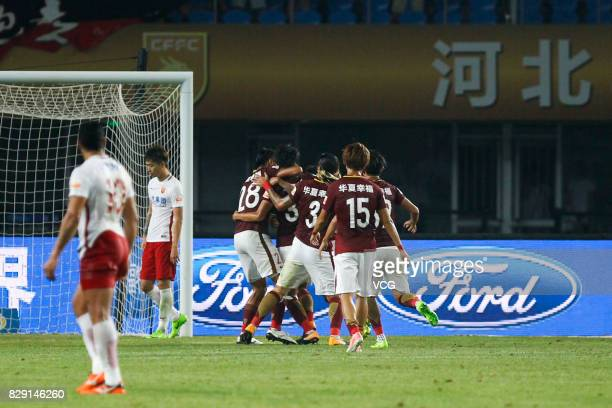 Gao Zhunyi of Hebei China Fortune celebrates with teammates after a goal during the 21st round match of 2017 China Super League between Hebei China...