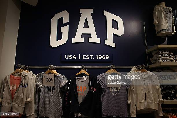 Gap clothing is displayed at a Gap store on February 20 2014 in San Francisco California Gap Inc announced that they will raise their minimum wage...