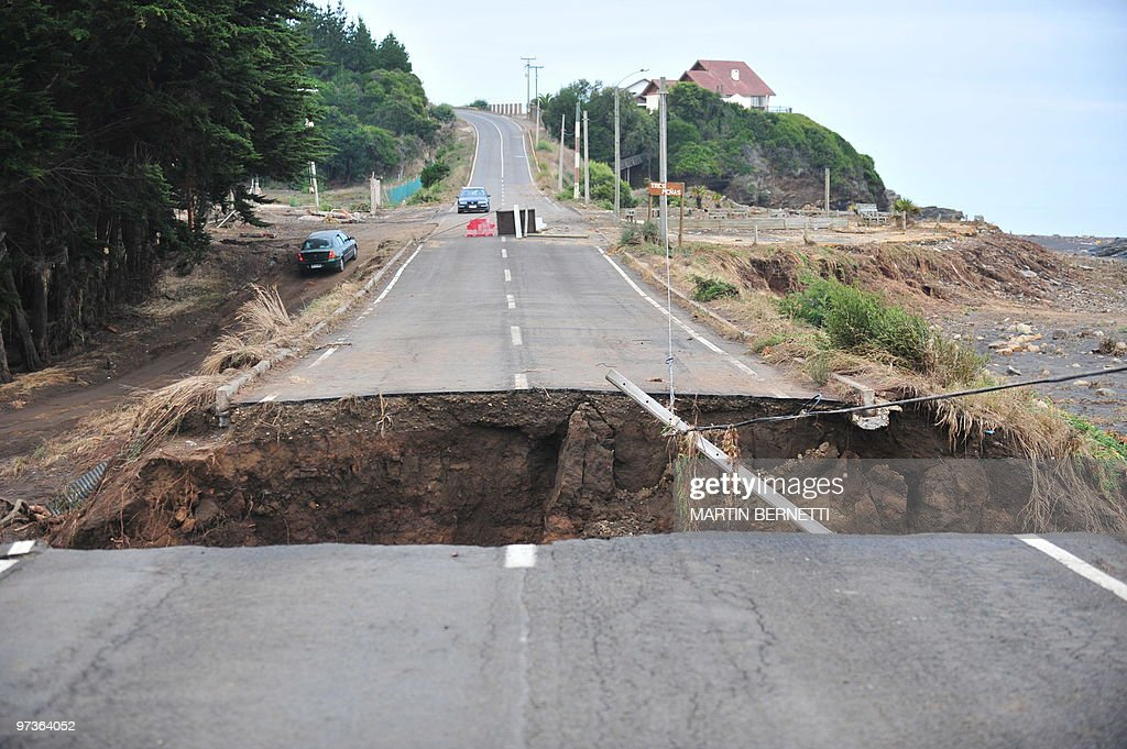 A gap in a road caused by Saturday's earthquake and the ensueing tsunami that killed at least 723 in Pulluhue 320 km south of Santiago march 2 2010...
