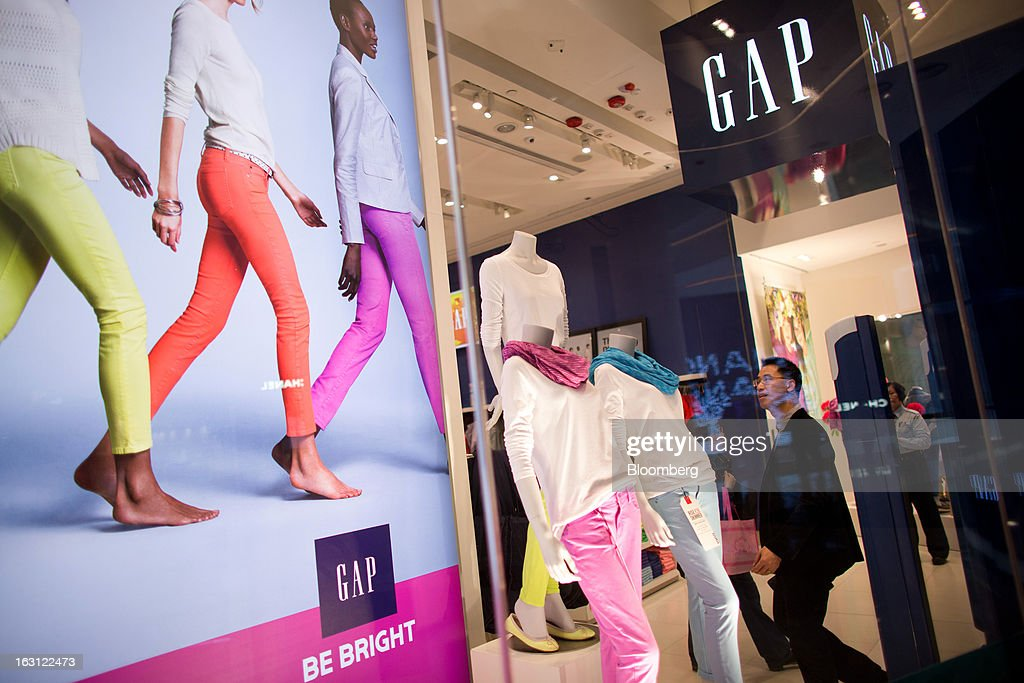 Gap Inc. merchandise is displayed in the store's window at Hysan Development Co.'s Hysan Place mall in the Causeway Bay district of Hong Kong, China, on Monday, March 4, 2013. Hysan is scheduled to release earnings on March 6. Photographer: Lam Yik Fei/Bloomberg via Getty Images
