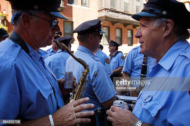 Gap Pallazola left of Ipswich and Bob Belmont right of West Newbury both members of the ItalianAmerican Band of Lawrence chat in between playing...