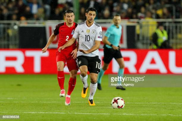 Gara Garayev of Azerbaijan and Lars Stindl of Germany battle for the ball during the FIFA 2018 World Cup Qualifier between Germany and Azerbaijan at...