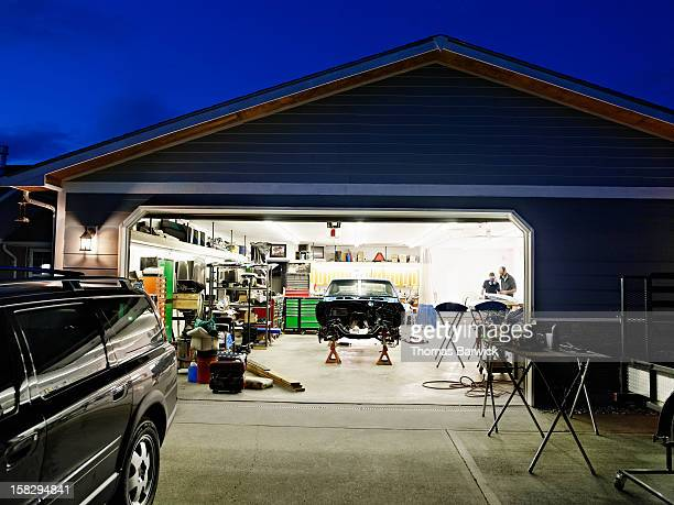 Garage at night with car restoration project