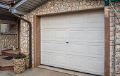 white plastic door on stone wall garage