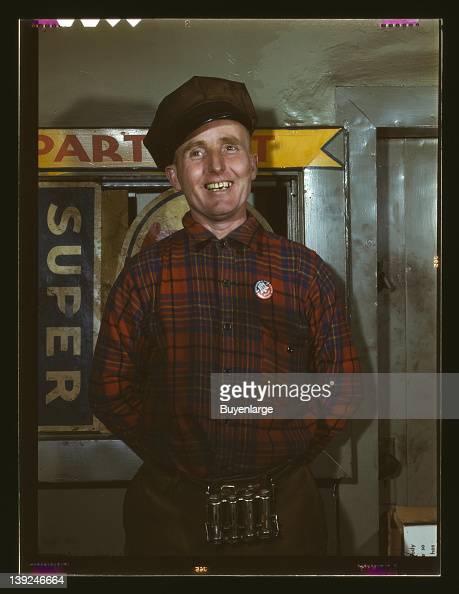 Garage mechanic near Newark New Jersey 1943 Badge denotes member of Office of Defense Transportation