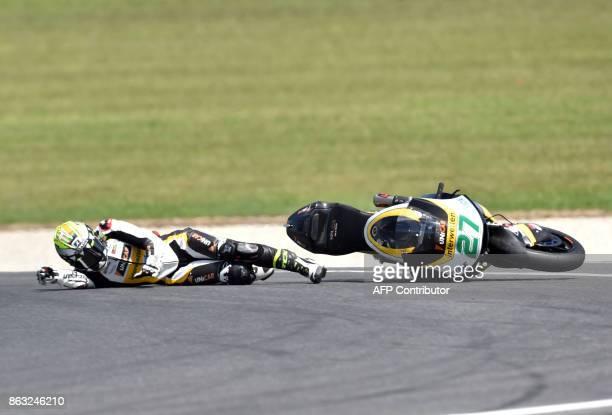 TOPSHOT Garage Plus Interwetten's Spanish rider Iker Lecuona crashes during the Moto2class first practice session of the Australian MotoGP Grand Prix...