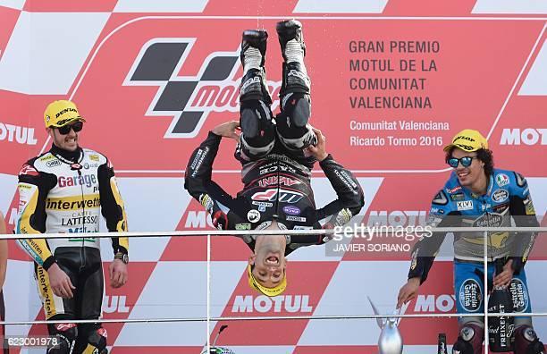 TOPSHOT Garage Plus Interwetten's Swiss rider Thomas Luthi and EG 00 Marc VDS's Italian rider Franco Morbidelli wathc as winner Ajo Motorsport's...