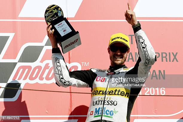 Garage Plus Interwetten's Swiss rider Thomas Luthi holds his trophy on the podium after the Moto2 race at the Japanese Grand Prix in the Twin Ring...