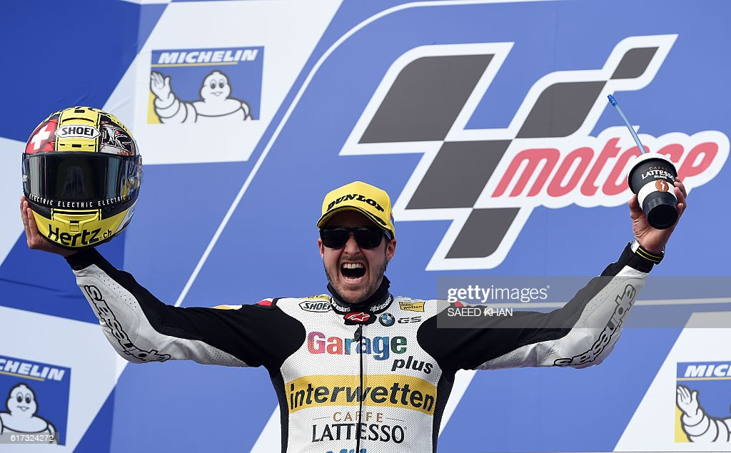 Garage Plus Interwetten's Thomas Luthi of Switzerland celebrates on the podium after the Australian Moto2 race at Phillip Island on October 23, 2016. / AFP / SAEED