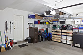 Simi untidy suburban garage with shelves and storage.