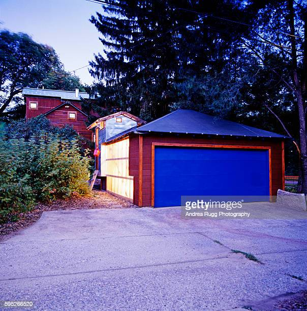 Garage with Blue Door and Translucent Wall Panels