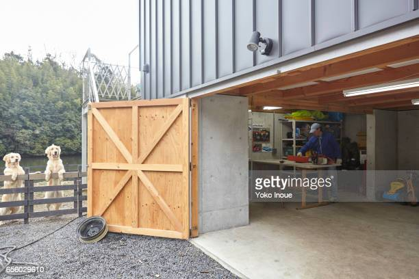 Garage workshop with dogs outside