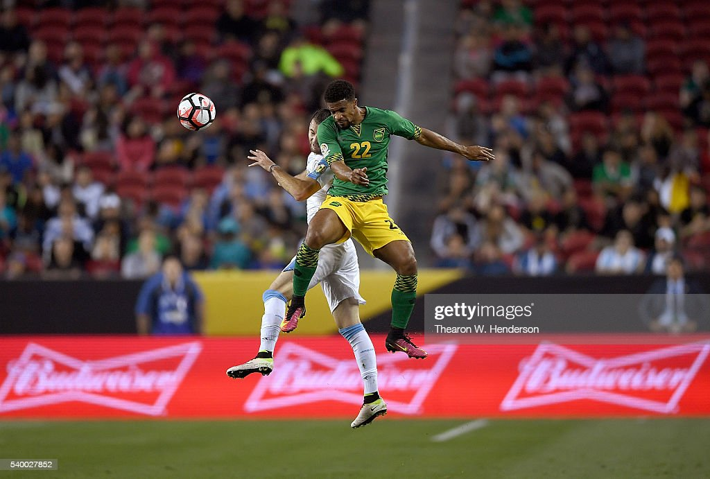 <a gi-track='captionPersonalityLinkClicked' href=/galleries/search?phrase=Garath+McCleary&family=editorial&specificpeople=5677409 ng-click='$event.stopPropagation()'>Garath McCleary</a> #22 of Jamaica hits a header away from Gaston Silva #19 of Uruguay during the 2016 Copa America Centenario Group match play between Uruguay and Jamaica at Levi's Stadium on June 13, 2016 in Santa Clara, California.