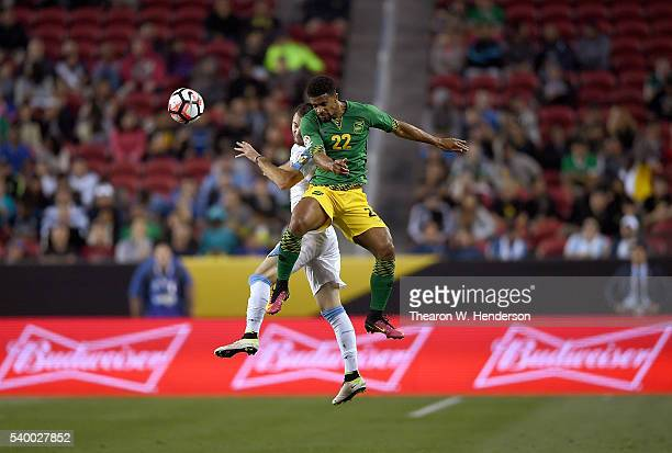 Garath McCleary of Jamaica hits a header away from Gaston Silva of Uruguay during the 2016 Copa America Centenario Group match play between Uruguay...