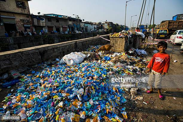 Garbage all over the place About 10000 labourers are working in 800 little companies mainly in the garbage recycling business at Dharavi Slum the...