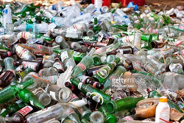 Garbage and litter from plastic bottles and glass bottles of coca cola and beer lie at the beach of Vagator on February 1 2012 in Goa India