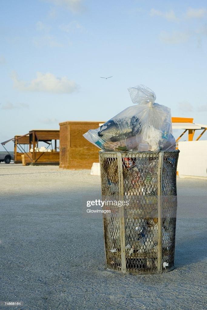 Garbage bin on the beach : Stock Photo