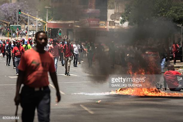 TOPSHOT Garbage burns in the road during a demonstration in Pretoria on November 2 2016 by members and supporters of South African opposition party...