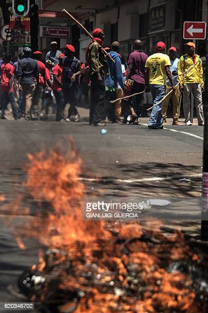 Garbage burns in the road during a demonstration in Pretoria on November 2 2016 by members and supporters of South African opposition party the...