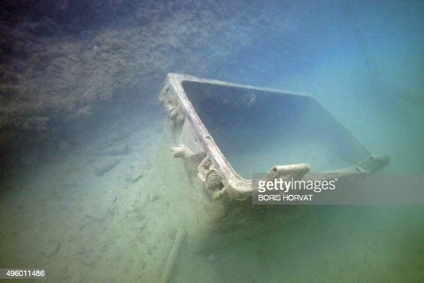 A garbage can is pictured on the eve of a cleaning campaign of Marseille's 'Vieux port' harbour sub sea floor in the Mediterranean sea on November 6...