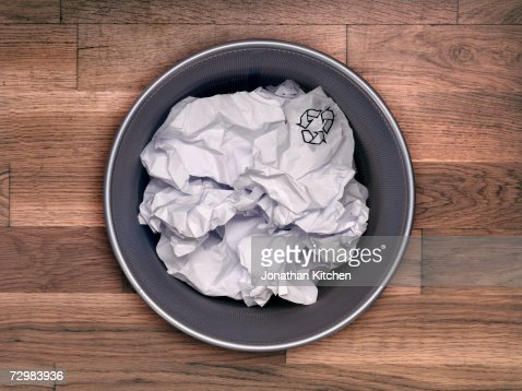 Garbage can with crumpled papers, overhead view