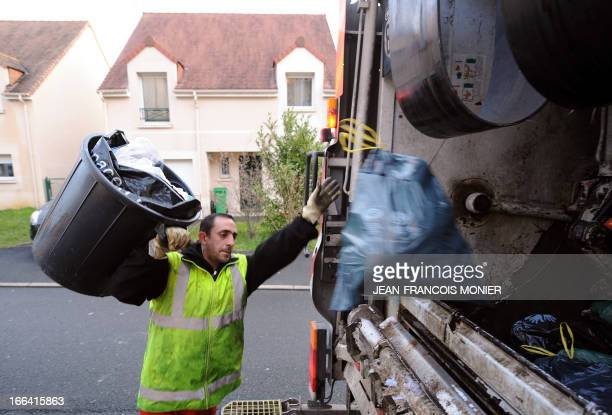 A garbage collector is at work in the streets of Le Mans western France on April 11 2013 AFP PHOTO / JEAN FRANCOIS MONIER