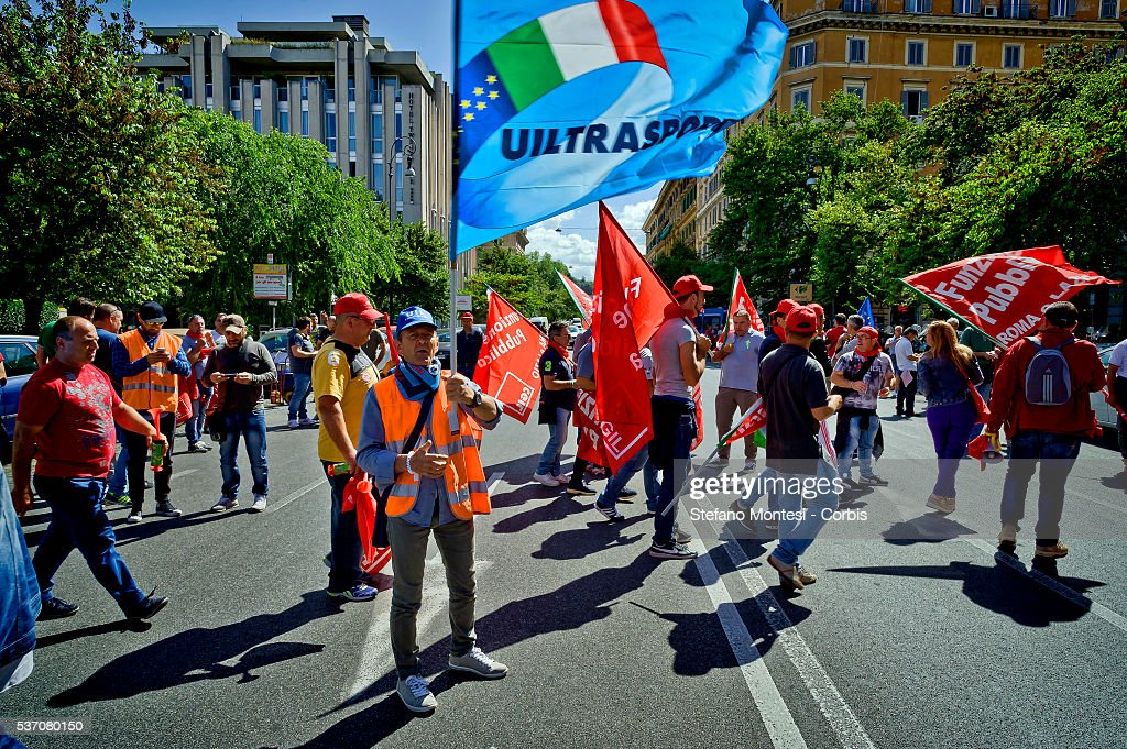 Garbage collectors strike today throughout Italy in support of the dispute for the contract renewal. The workers conducted a protest outside the headquarters of Utilitalia, the association representing the energy and environmental water companies on May 30, 2016 in Rome, Italy. The adherence to the strike was 90% of the 7,800 employees of Ama (Municipal Environment Company Rome) and across Italy where there are about a hundred thousand workers. (Photo by Stefano Montesi/Corbis via Getty Images).