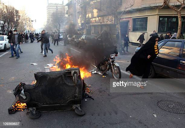 SOURCESA garbage container is set on fire as Iranian protesters stage an antigovernment demonstration under the pretext of rallies supporting Arab...
