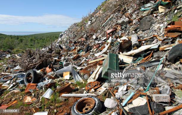 Garbage Dumped On A Hillside Creating An Environmental Eyesore