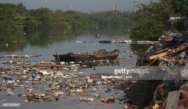 Garbage floats in the polluted Cunha canal which flows into the notoriously polluted Guanabara Bay site of sailing events for the Rio 2016 Olympic...