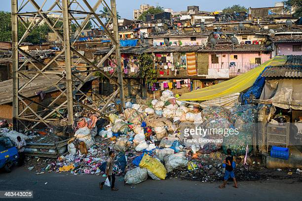 Garbage is piling up between houses About 10000 labourers are working in 800 little companies mainly in the garbage recycling business at Dharavi...