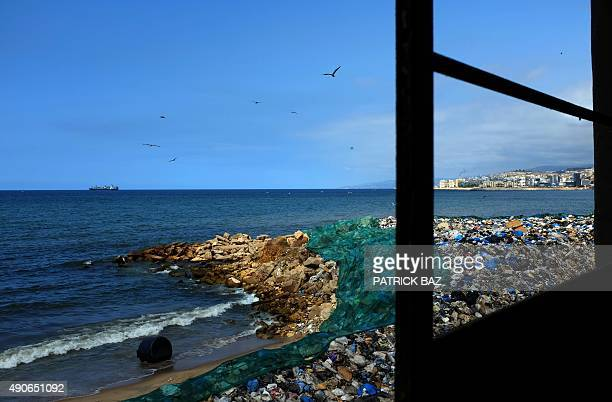 Garbage is seen from the window of a building piled up at a temporary dump on a beach in Zalka north of Beirut on September 30 2015 AFP PHOTO/PATRICK...