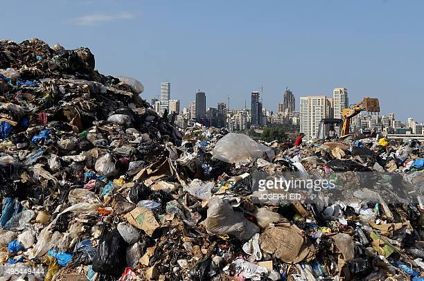 Garbage piles up at a temporary garbage dump in the eastern suburb of Beirut on November 3 2015 Garbage crisis began in midJuly 2015 as pungent piles...