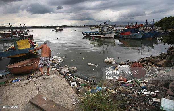 Garbage rests on the polluted Guanabara Bay on March 22 2015 in Rio de Janeiro Brazil Guanabara Bay is set to be the sailing and windsurfing venue...