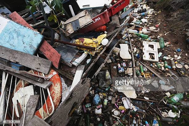 Garbage rests on the shoreline of polluted Guanabara Bay on March 22 2015 in Rio de Janeiro Brazil Guanabara Bay is set to be the sailing and...