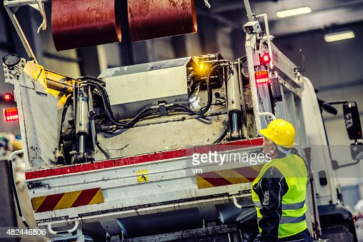 Garbage truck with worker