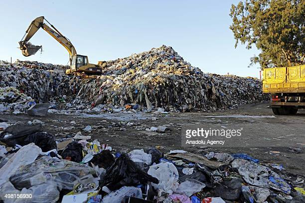 Garbages are being collected at the temporary dump site in quarantine region near Beirut River in Beirut Lebanon on November 21 2015 Lebanese...