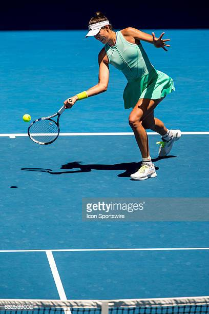 Garbiñe Muguruza of Spain returns the ball during the Quarter Finals of the 2017 Australian Open on January 24 at Melbourne Park Tennis Centre in...