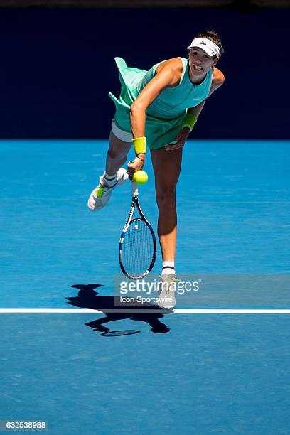 Garbiñe Muguruza of Spain serves the ball during the Quarter Finals of the 2017 Australian Open on January 24 at Melbourne Park Tennis Centre in...