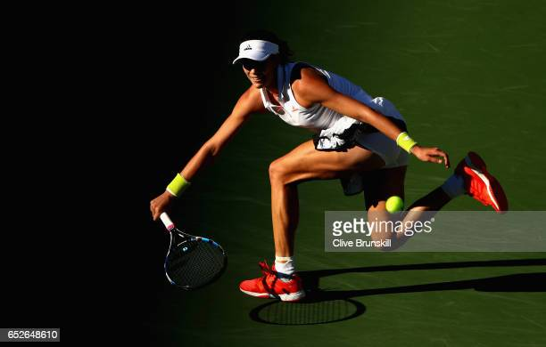 Garbine Mugaruza of Spain in action against Kayla Day of the United States in their third round match during day seven of the BNP Paribas Open at...