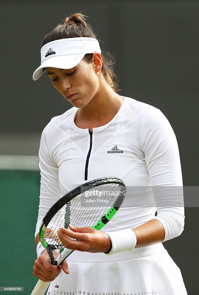 Garbine Mugaruza of Spain looks on during the Ladies Singles second round match against Jana Cepelova of Slovakia on day four of the Wimbledon Lawn Tennis Championships at the All England Lawn Tennis and Croquet Club on June 30, 2016 in London, England.