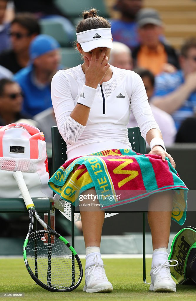 Garbine Mugaruza of Spain looks on following defeat during the Ladies Singles second round match against Jana Cepelova of Slovakia on day four of the Wimbledon Lawn Tennis Championships at the All England Lawn Tennis and Croquet Club on June 30, 2016 in London, England.