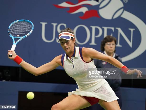 Garbine Mugurusa of Spain hits a return to Petra Kvitova of the Czech Republic during their 2017 US Open Women's Singles match at the USTA Billie...