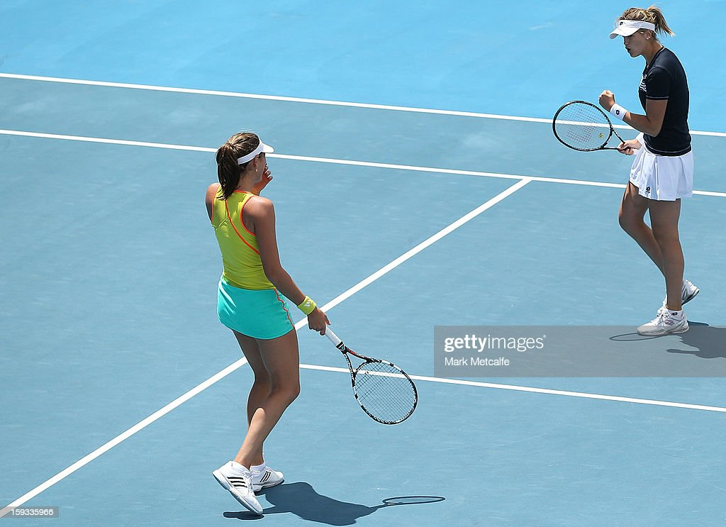 Garbine Muguruza and Maria-Teresa Torro-Flor of Spain celebrate winning a point in their doubles final match against Timea Babos of Hungary and Mandy Minella of Luxembourg during day nine of the Hobart International at Domain Tennis Centre on January 12, 2013 in Hobart, Australia.